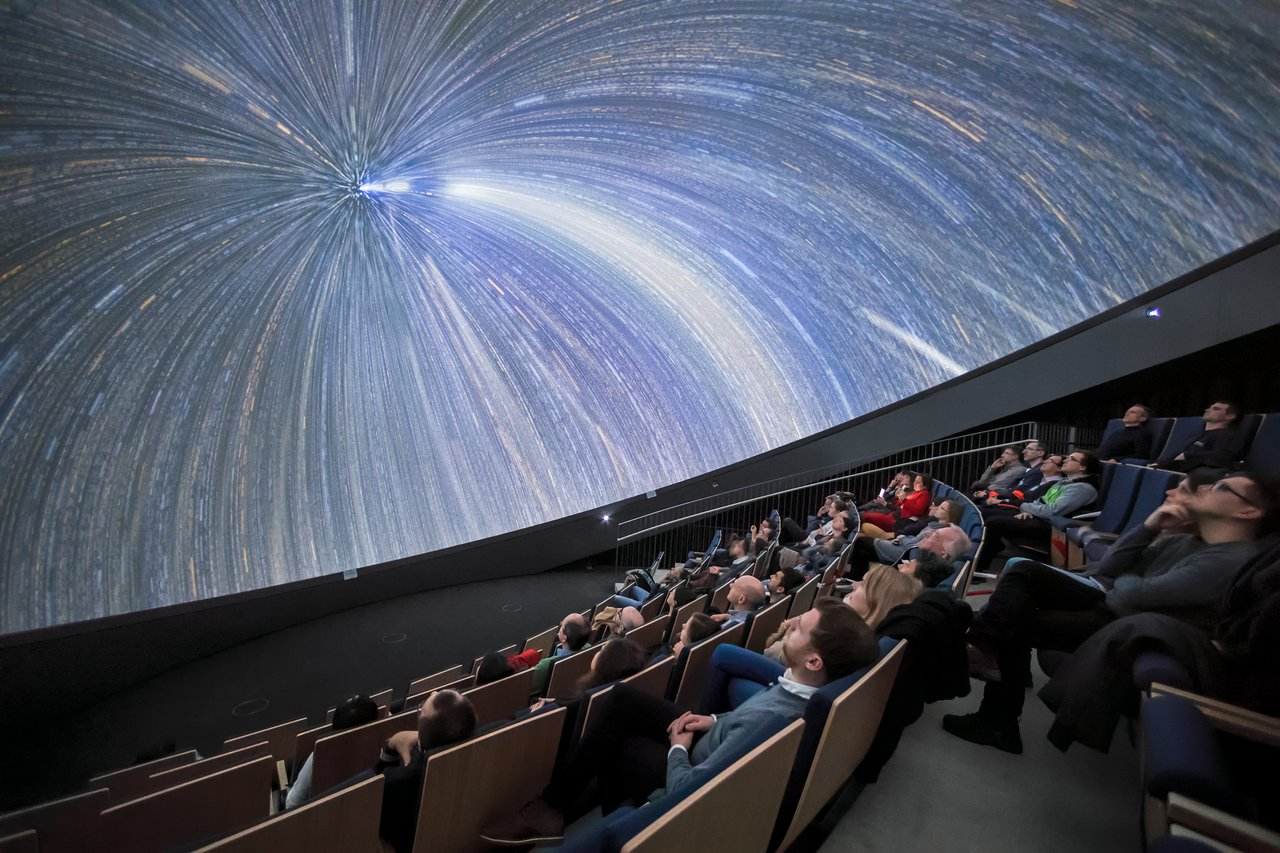 ESON members watch a show at the ESO Supernova